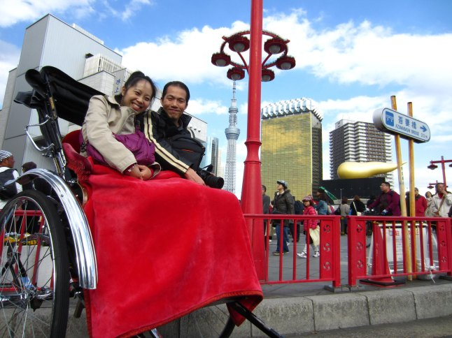 On the rickshaw with the view of the Sky Tree and Asahi Breweries